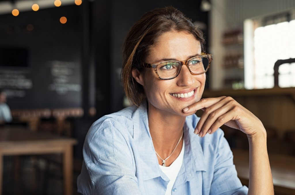 smiling woman with glasses cosmetic specials